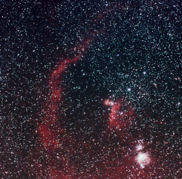 "Barnard's Loop in Orion (Sharpless catelog - Sh2-276). An arc of high temperature ionised hydrogen gas around Orion - probably the remnant of an old supernova explosion. It forms the backbone of a ""G-shape"" with the burning bush and horsehead nebulae at the crossbar. Orion nebula is bottom right"